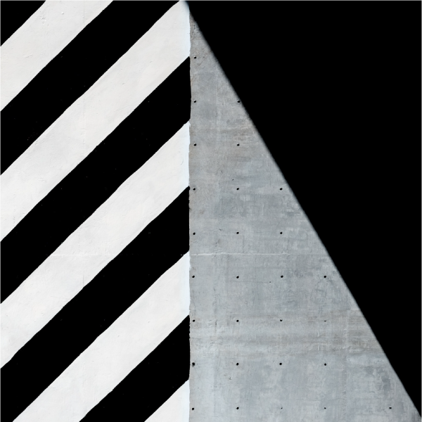 a rectangle of diagonal black and white lines next to a rectangle made up of a grey triangle and a black triangle.